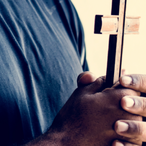 male, african american hands holding cross