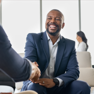african american men shaking hands in meeting