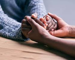 african american hands holding each other in prayer