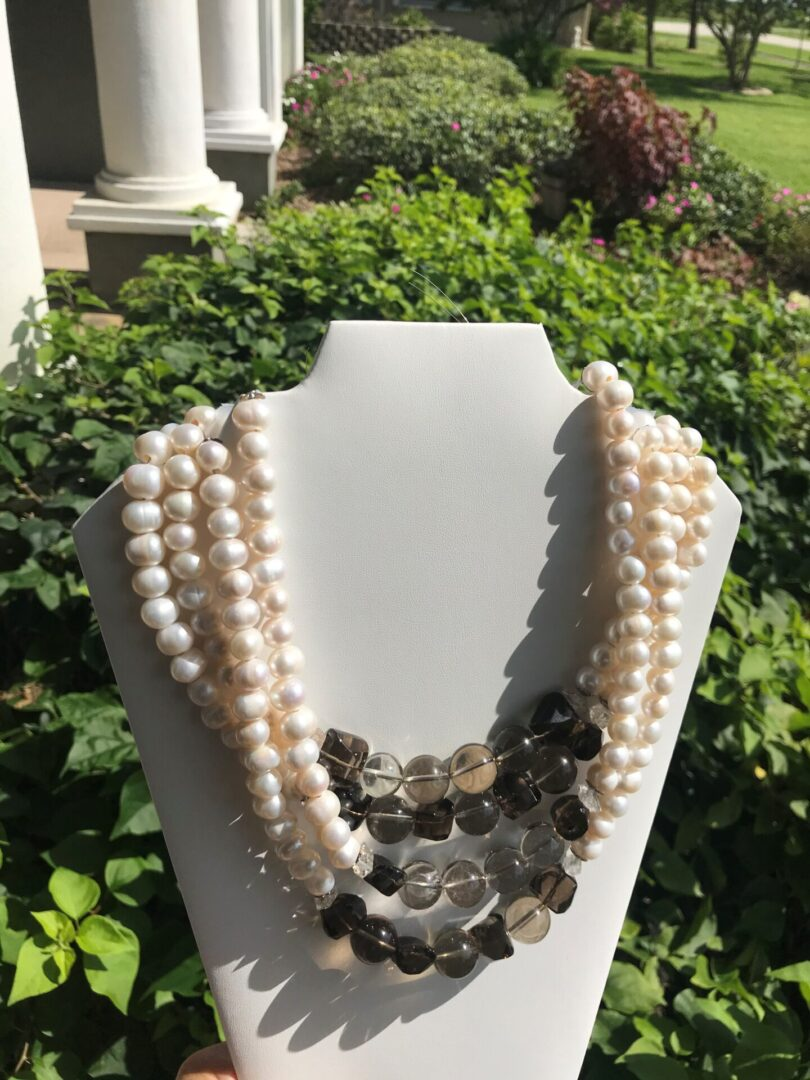 Four pearl strands