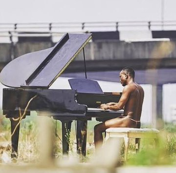 The main Reason why Brymo wore a G-String and Played Piano in A beach