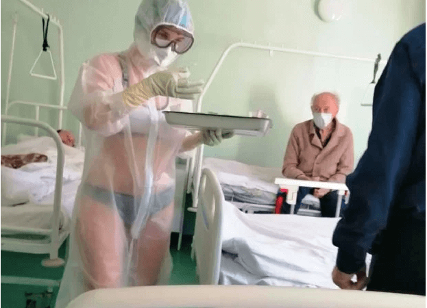 """A Russian nurse wearing """"lingerie"""" beneath her transparent gown while treating male coronavirus victims faces Sack"""