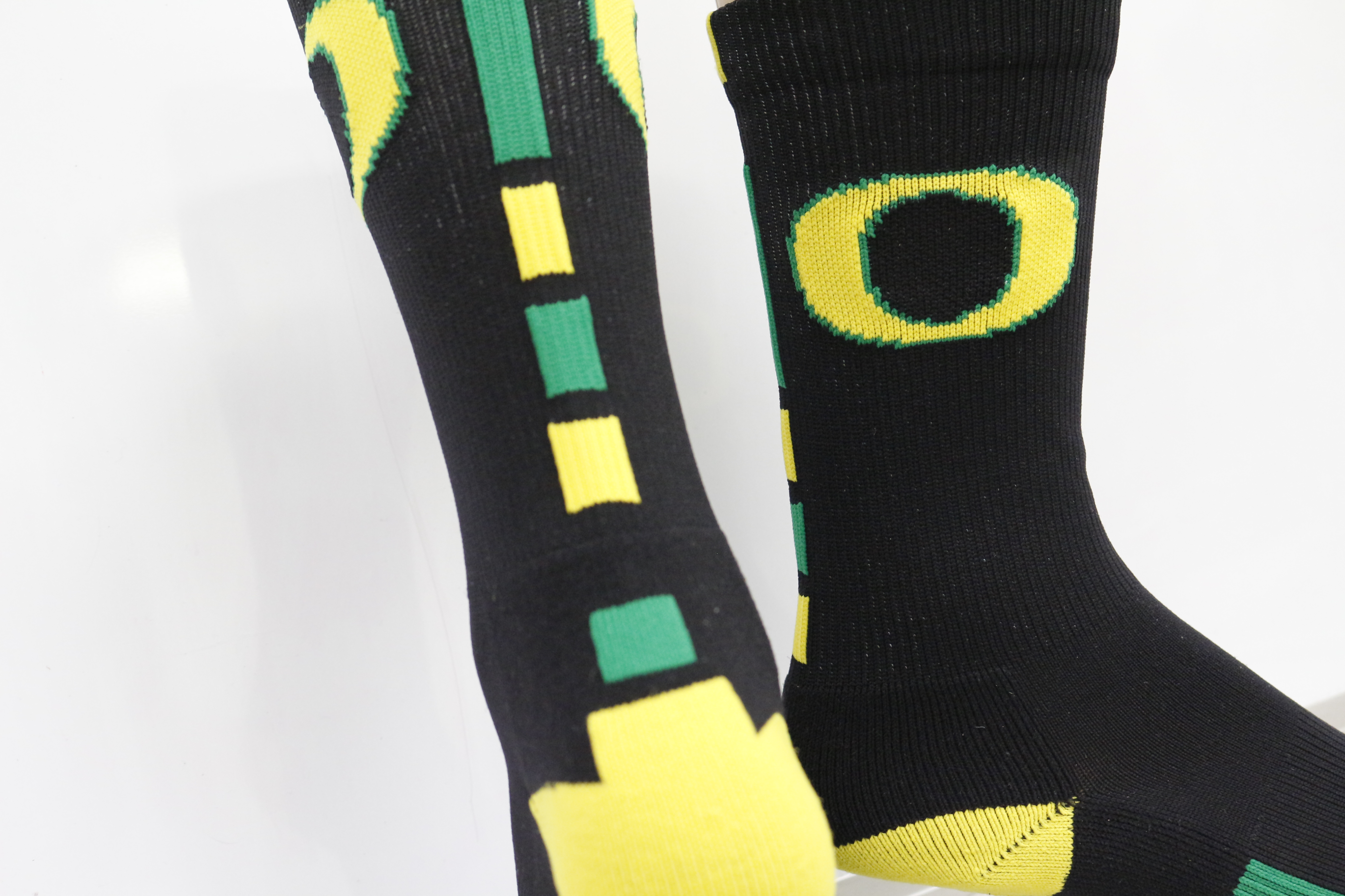 gallery sock sample letter o black green and yellow