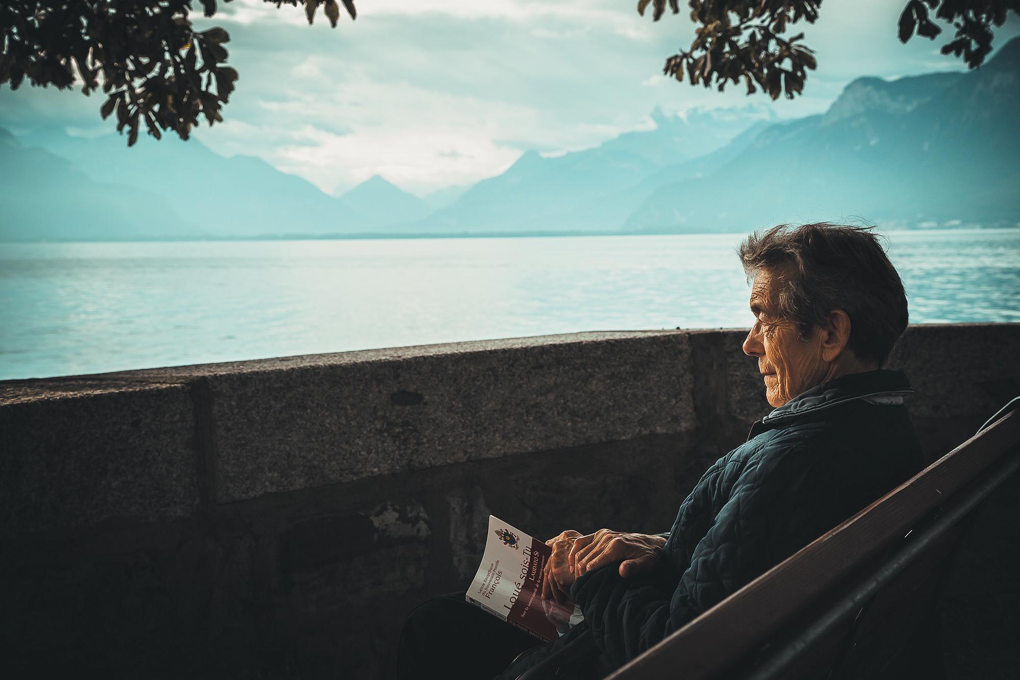 Man Reading by Lake