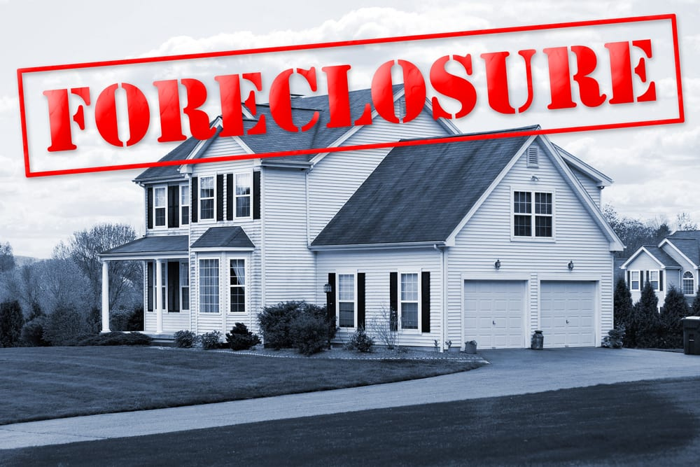 foreclosure   home with foreclosure sign