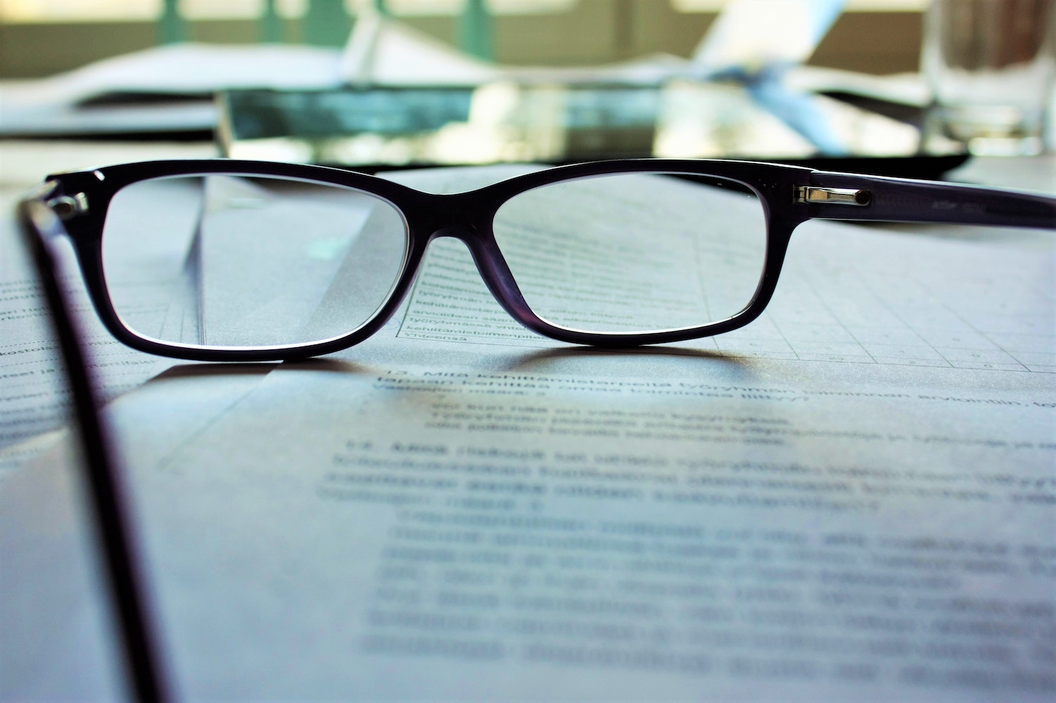 boilerplate contract   glasses on papers