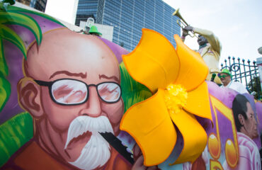 A Mardis Gras parade float rides by the Hyatt Regency in New Orleans, LA (photo credit: Linux Foundation)