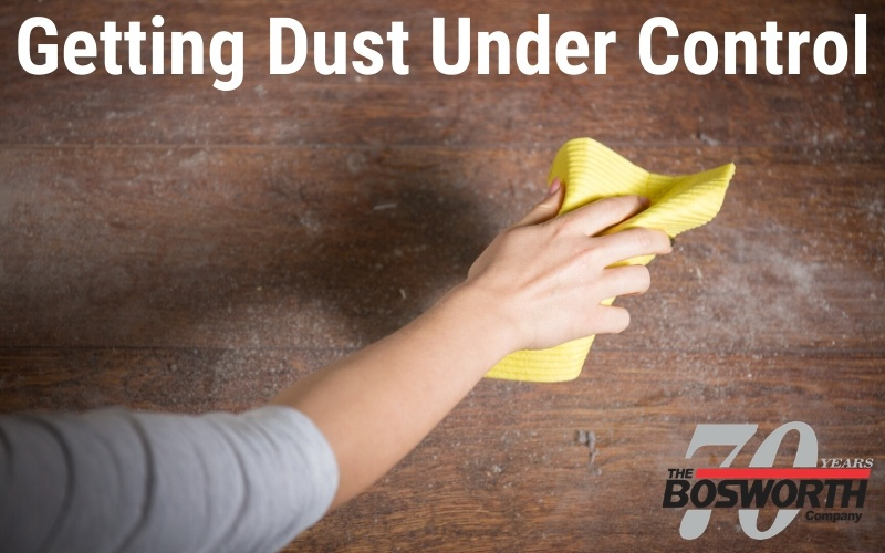 Woman wiping up excessive dust