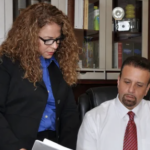 Montes and Associate looking at documents