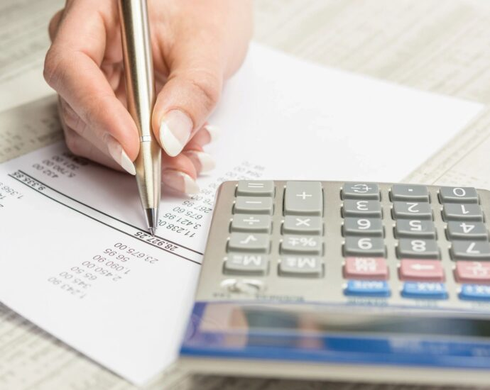 person doing taxes with calculator