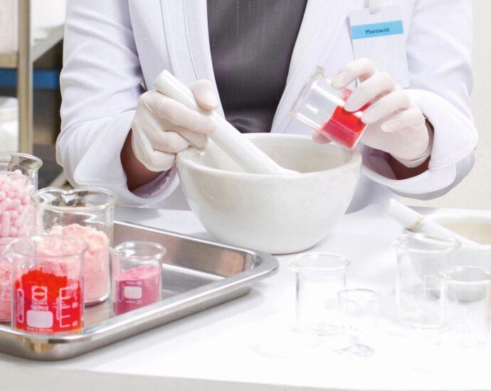 Pharmacist mixes medicine