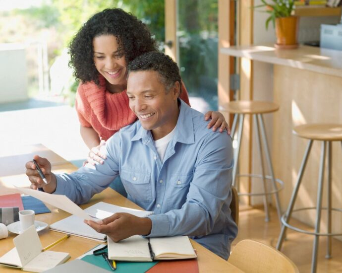 couple happily looking at bills