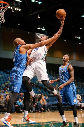 Reno Bighorn RA'SHAD JAMES (10) soars to the basket and draws the foul against Oklahoma City Blue RODNEY WILLIAMS (34) during the NBA D-League Basketball game between the Reno Bighorns and the Oklahoma City Blue at the Reno Events Center in Reno, Nevada.