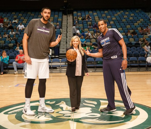 Reno Mayor Hillary Schieve has a ceremonial tip off with Reno Bighorn Center SIM BHULLAR (44) and Texas Legends Forward RON ANDERSON (34)