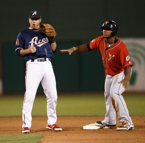 Both Reno Aces Outfield MIKE FREEMAN (1) and El Paso Chihuahuas Left Field RYMER LIRIANO (28) react to the umpire's call on the close play at second base