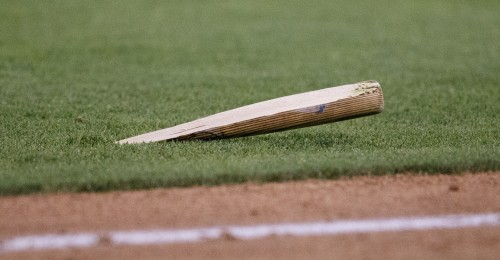 A broken bat flew half way down the third baseline and stuck into the ground during the MiLB game