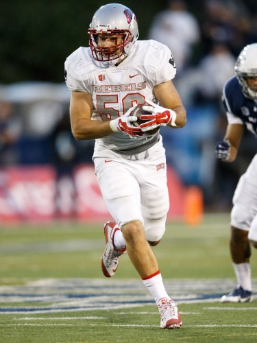 UNLV's Ryan McAleenan (56) picks off a pass and takes it to the end zone