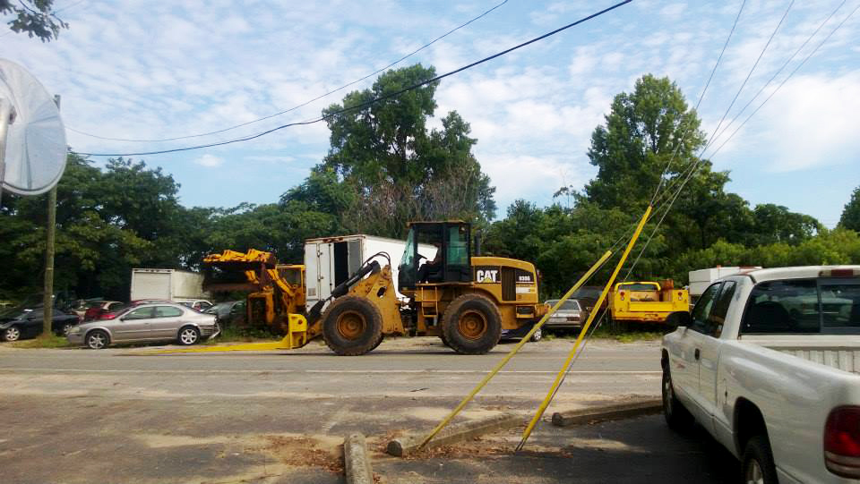 Forklift on the way to move another car