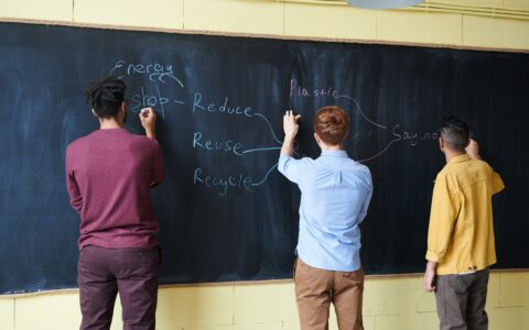 men-wriiting-on-blackboard-with-chalks-3184636