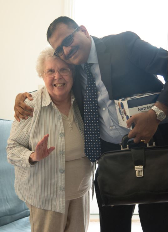 Concierge Medicine Physician Dr. Murthy Gokula with female patient