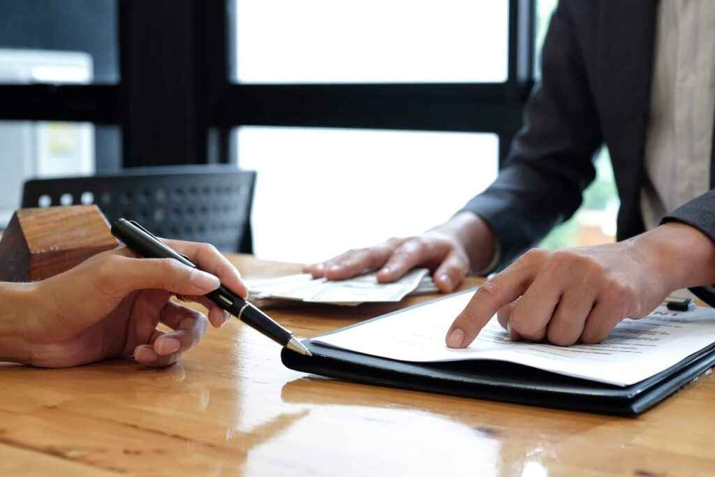 Photo of lawyer pointing to a contract.