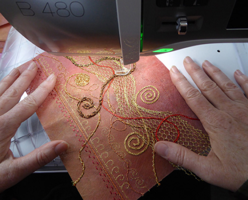 Christina Fairley Erickson stitching by machine with metallic threads- part of a hand-made book by Christina Fairley Erickson based on Celtic patterns and swirls.
