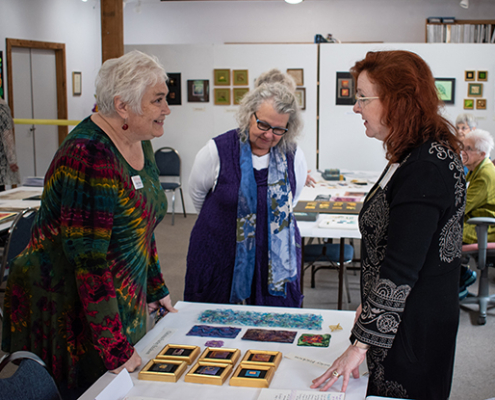 Christina Fairley Erickson discussing her work with Amy Green, Exec Director of the Pacific NW Quilt and Fiber Art Museum