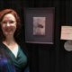 "Christina Fairley Erickson with her 3rd place entry ""Cheeky Blue Heron"" at the International Quilt and Fiber Art Exhibition 2019"