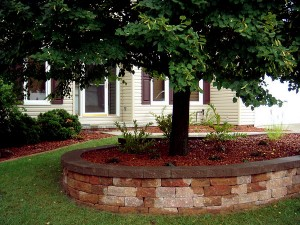 Circular Retaining Wall & Landscaping by Nebraska Yard Care. A Landscaping Company.