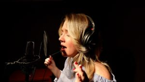 Annie Bonsignore singing into microphone