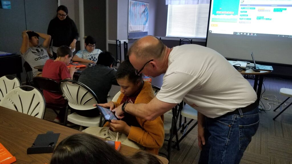 GEtMECoding Mr Fred helping students
