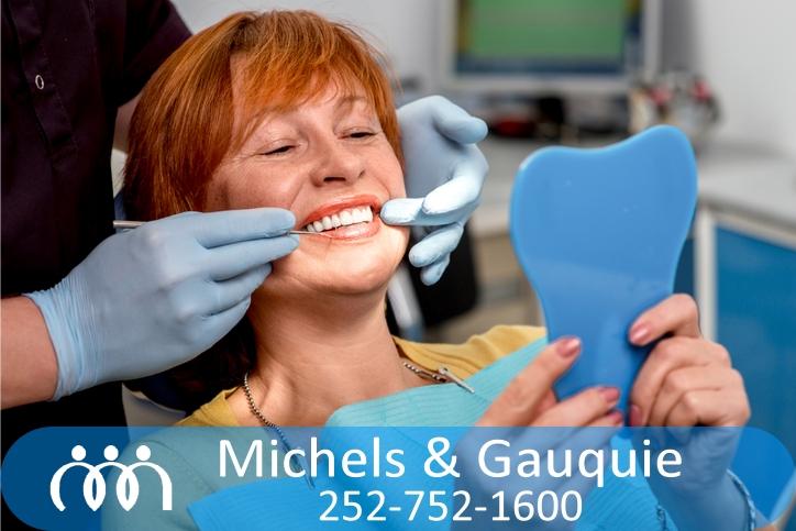 older woman having dentures cleaned