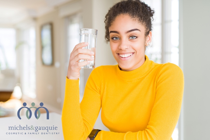 Water helps oral health with logo