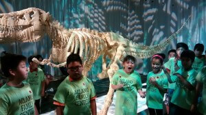 Students react to lego dinosaur.