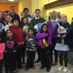 Students and faculty members from Episcopal Academy pause during distribution for a picture with some recipient families.