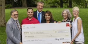 ACLAMO's Nelly Jimenez joins officials from Wells Fargo Bank and Morris Arboretum.