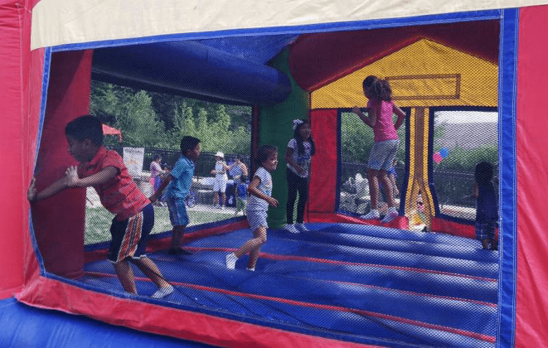 "Children enjoy bouncing on the ""moon"" while their parents deal with down-to-earth health issues."