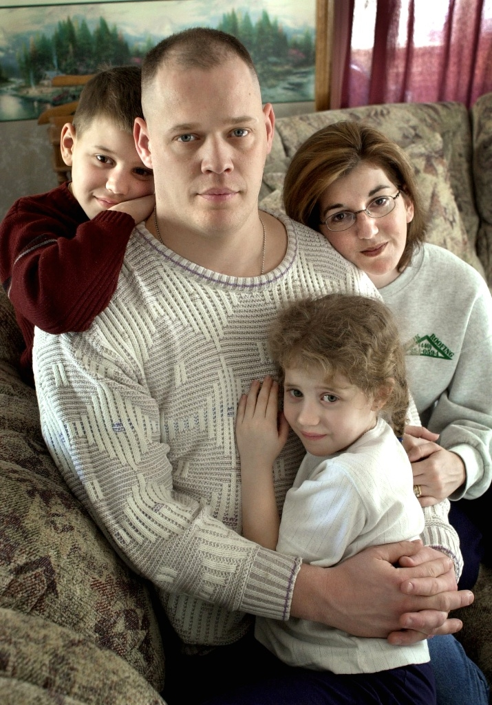 Paul Shook poses with his family the day before leaving for the Iraq War
