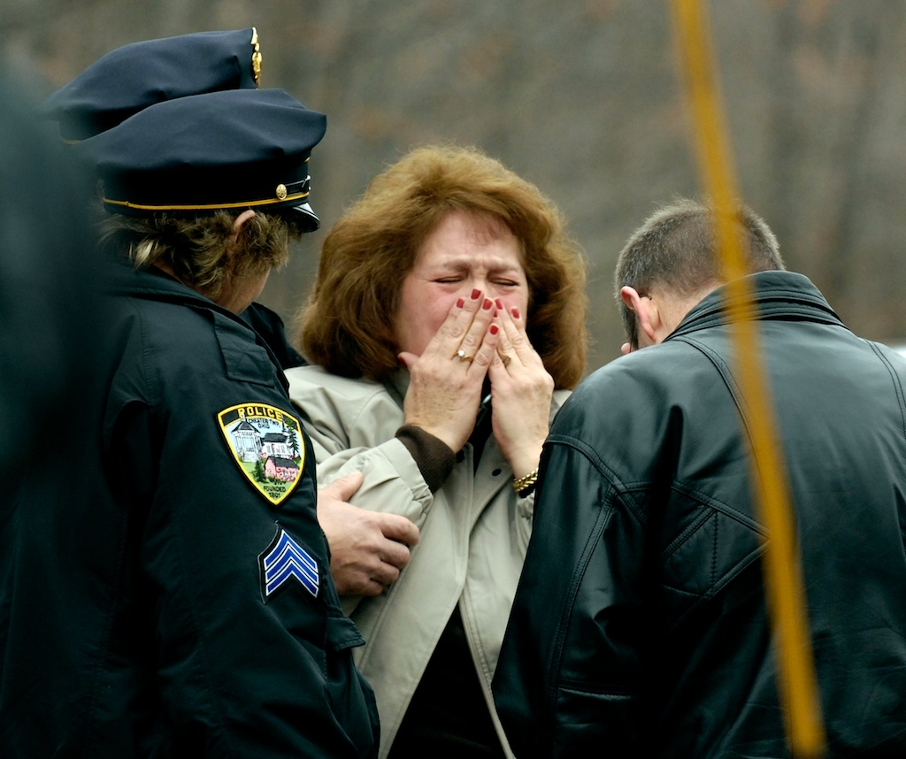 A mother reacts as she learns of her daughter's murder