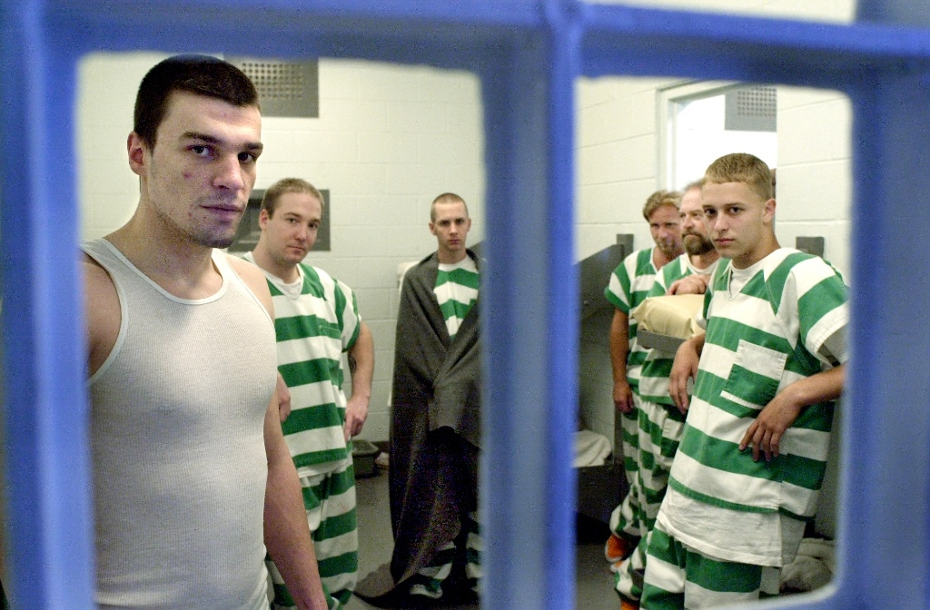 Prisoners pose for a photo in their cell at the Geauga County jail.