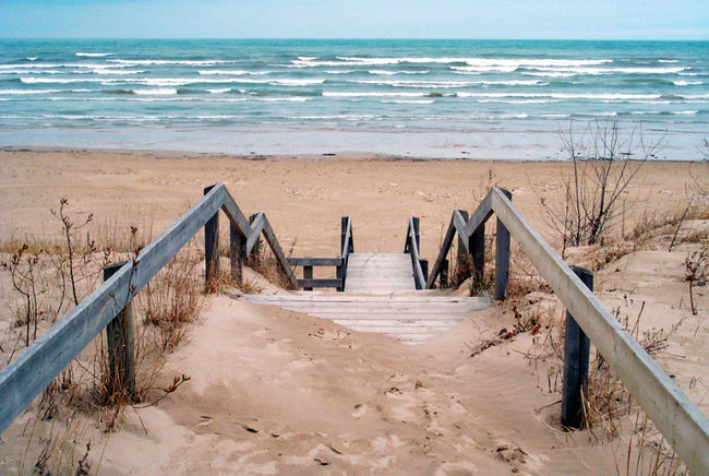 Sand covered steps to the waters edge