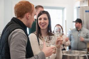 couples tasting their wedding wine