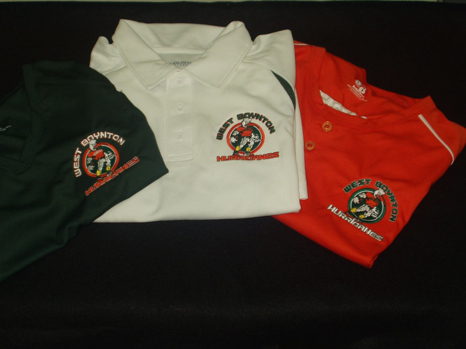Different color polo shirts with custom team embroidery