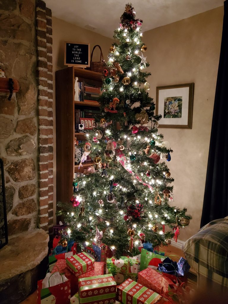 Christmas tree lit up with one missing section