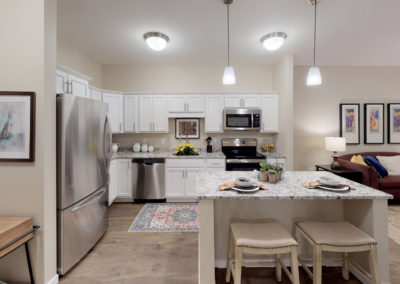 Havenwood of Burnsville Senior Living Apartment Kitchen and Living Area