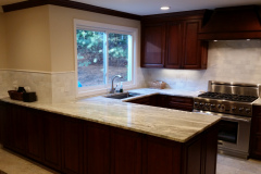 Cherry Cabinets with Marble backsplash and Marble Countertop