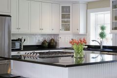 Modern kitchen with White Cabinets and Granite Counterop