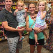 Runner family posing for picture inside store