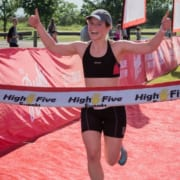 Woman happily crosses finish line