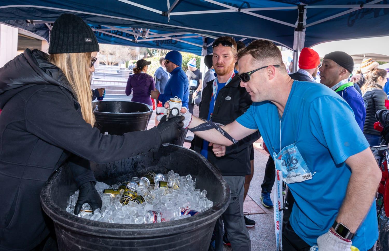 In 2018, runner gets a beer from Oskar Blues, the Official Beer Sponsor of the 3M Half Marathon.